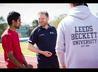 Carnegie Sports Staff Coaching two male Students